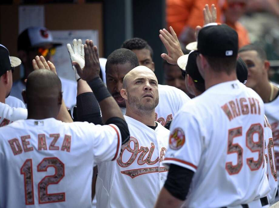 The Orioles' Steve Pearce, center, celebrates his two-run home run against the Houston Astros in the the seventh inning. The Orioles won 4-3. Photo: Nick Wass