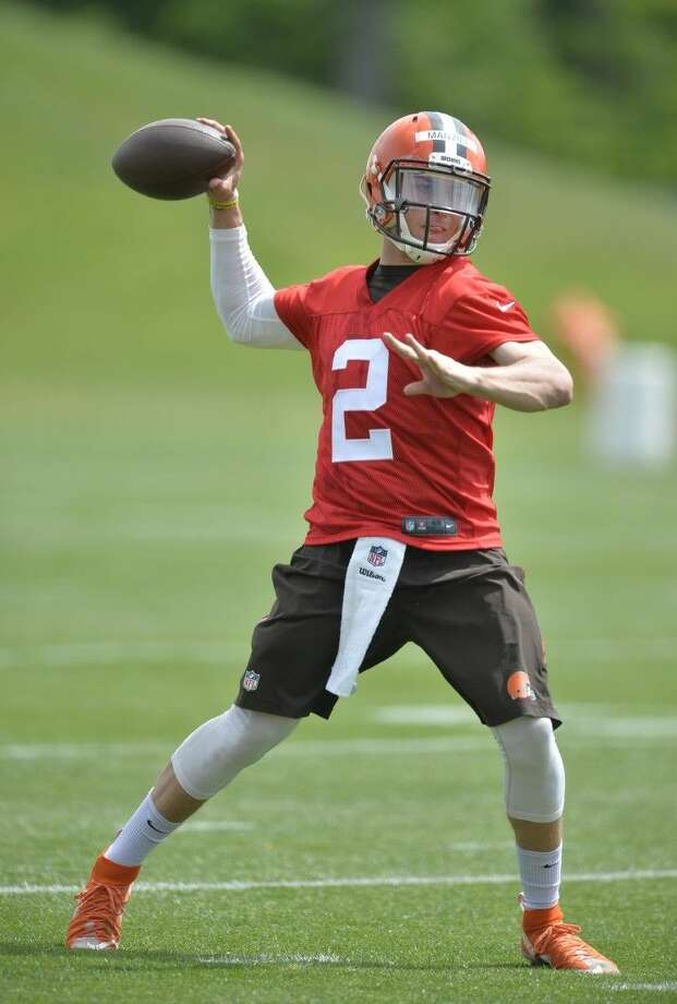 Cleveland Browns quarterback Johnny Manziel throws a pass during an NFL football organized team activity, Tuesday in Berea, Ohio. Photo: David Richard