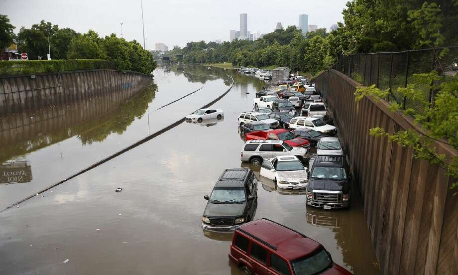 Motorists are stranded along I-45 along North Main in Houston after storms flooded the area, Tuesday. Photo: Cody Duty