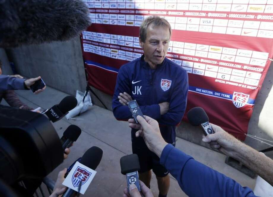 United States coach Jurgen Klinsmann fields questions during the team's training camp in preparation for the World Cup on Wednesday in Stanford, Calif. Photo: Marcio Jose Sanchez