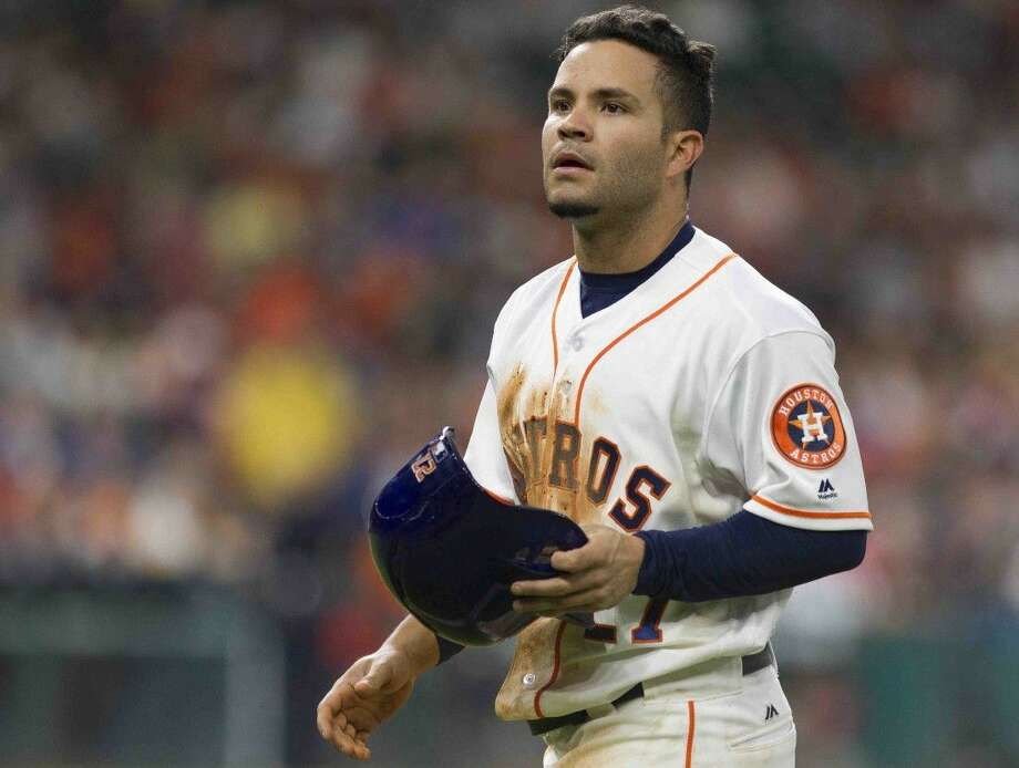 Houston Astros second baseman Jose Altuve walks back to the dugout after getting picked off by Detroit Tigers pitcher Justin Verlander during the third inning of an MLB baseball game Saturday. Photo: Jason Fochtman