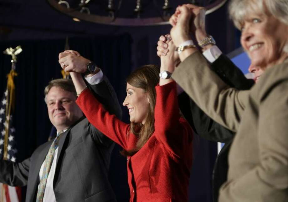 U.S. Senate candidate Alison Lundergan Grimes, center, celebrated on stage with husband Andrew Grimes, left, Gov. Steve Beshear, second from right and former Gov. Martha Lane Collins, right, after she gave her victory speech at her primary election night celebration at the Carrick House in Lexington Lexington, Ky., on Tuesday.