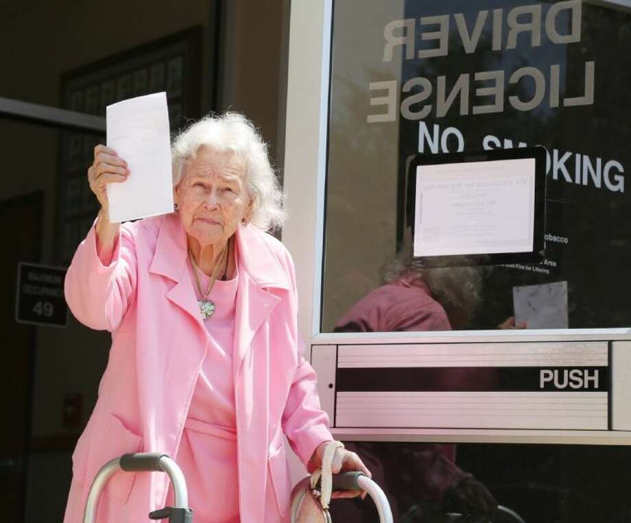 Ruby Barber, 92, leaves the Texas DPS office Tuesday with her temporary new voter ID card.