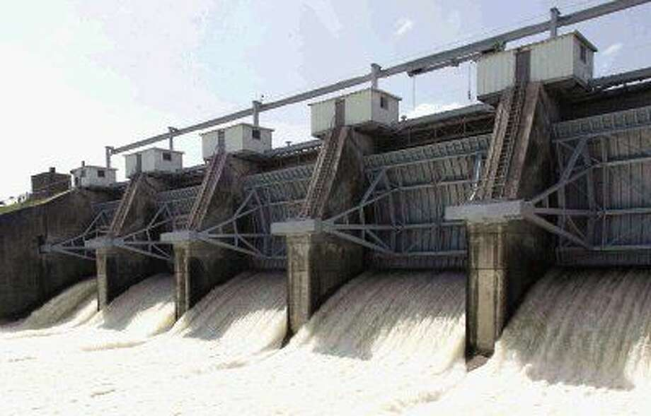 Water is released from the Lake Conroe Dam into the San Jacinto River Wednesday afternoon at 8,660 cfs.