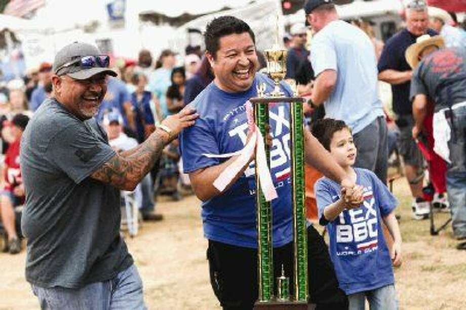 The Demontrond/Pitmaker cook team won Grand Champion overall along with a slew of other awards during the 2016 Bud Light BBQ Cook-Off on Saturday at the Montgomery County Fairgrounds.