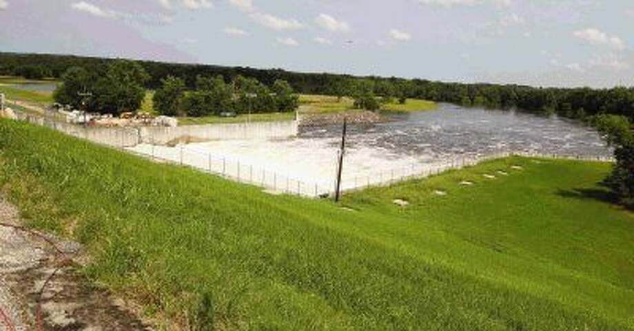 Water is released from the Lake Conroe dam into the San Jacinto River Wednesday afternoon.