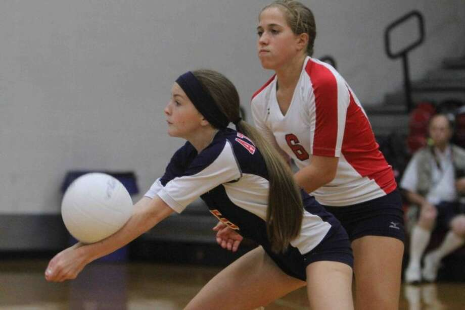 Bradyn Rice returns a serve as Chelsea Johnson looks on during a non-district match earlier this season. Photo: Staff Photo By Jason Fochtman