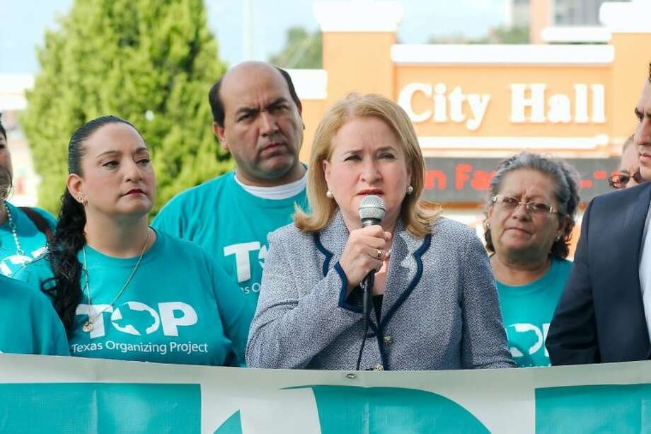 State Senator Sylvia Garcia (center) joins member of the Texas Organizing Project as they voice opposition to the proposed redistricting plan Tuesday (September 17) in front of City hall. Photo: KIRK SIDES