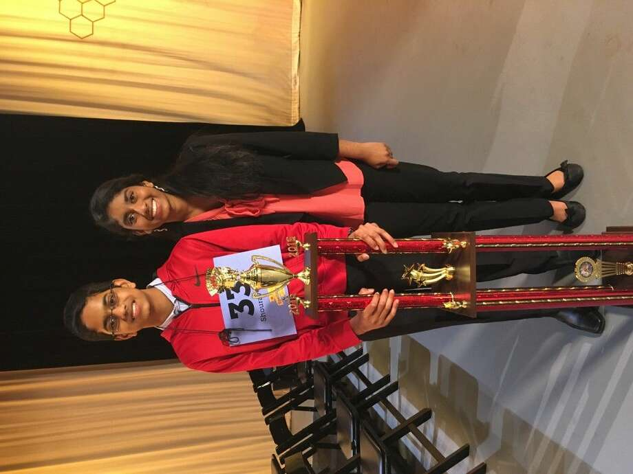 Shourav Dasari, a McCullough Junior High seventh-grader, poses with his trophy after winning the 2016 Houston Public Media Spelling Bee - the second largest in the nation. Next to him is his sister Shobha Dasari, a three-time winner of the Houston event.