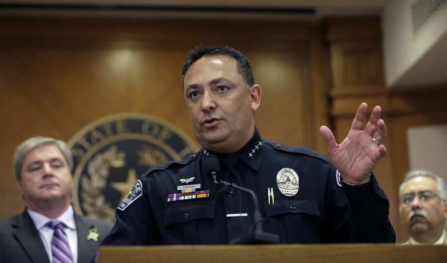 Austin Police Chief Art Acevedo stands with other members of law enforcement from around Texas to oppose a provision barring officers from asking someone carrying a handgun if they are licensed to have it, Wednesday in Austin. Photo: Eric Gay