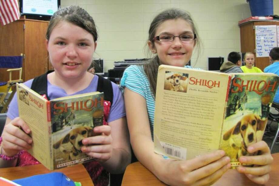 Grangerland students enjoy reading, Shiloh, together in the library.