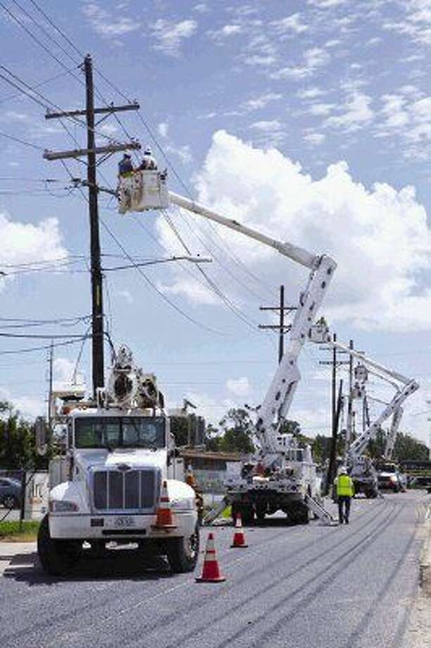 Entergy crews working to restore power following a storm.