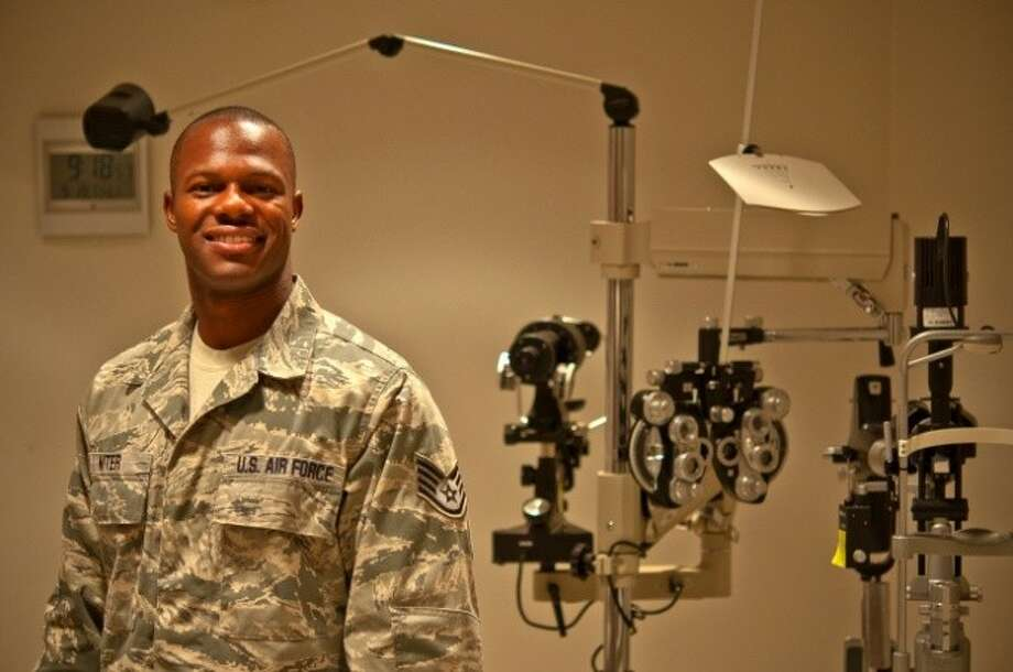 Air Force Staff Sgt. Robert Niter III, 47th Medical Operations Squadron NCO in charge of optometry, poses for a photo in the optometry clinic at Laughlin Air Force Base, Texas, Sept. 19, 2013. During a recent visit to Houston, Niter used his medical knowledge and intuition when he saw a downed pedestrian unconscious and not breathing. His quick lifesaving actions revived and kept the pedestrian alive until rescue personnel arrived on-scene. Photo: Senior Airman Scott Saldukas