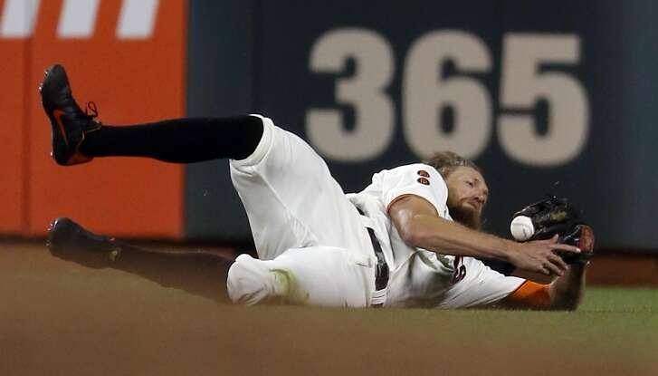 San Francisco Giants' Hunter Pence can't catch a line drive by Colorado Rockies' Cristhian Adamesin 9th inning of Giants' 7-2 win during MLB game at AT&T Park in San Francisco, Calif., on Thursday, September 29, 2016.