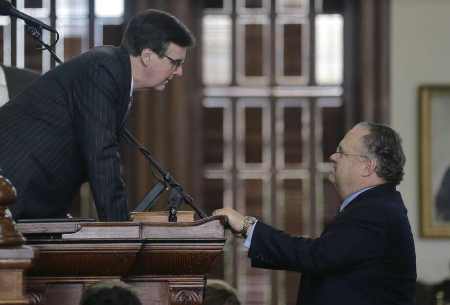 Lt. Gov. Dan Patrick, left, talks with Sen. Craig Estes, R-Wichita Falls, right, in the Senate Chamber at the Texas Capitol in Austin. Photo: Eric Gay