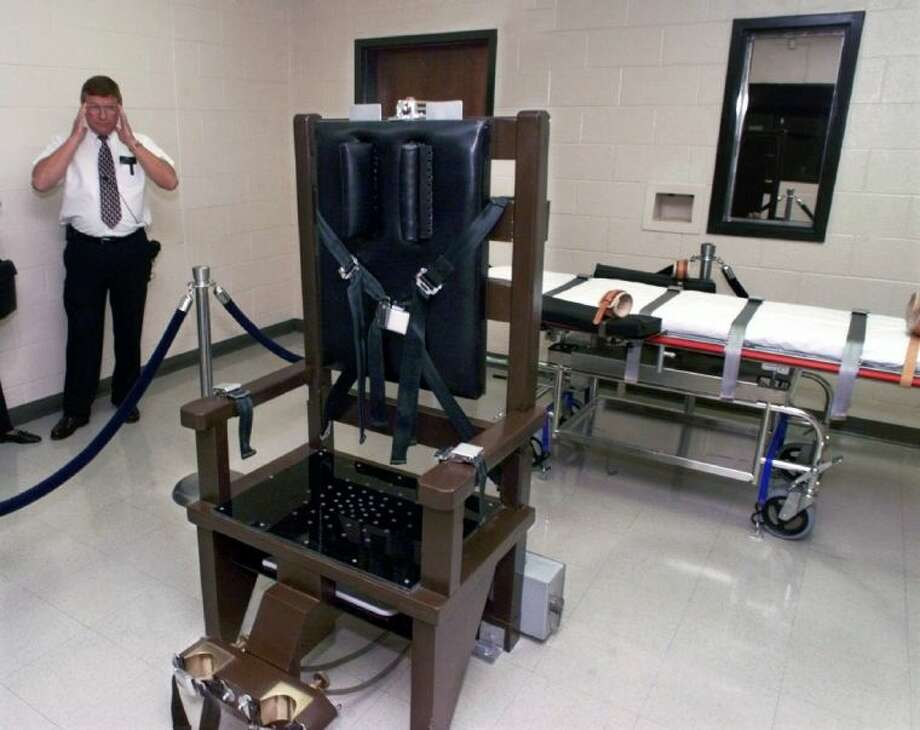 In this Oct. 13, 1999 file photo, Ricky Bell, then warden at Riverbend Maximum Security Institution in Nashville, Tenn., gives a tour of the prison's execution chamber.