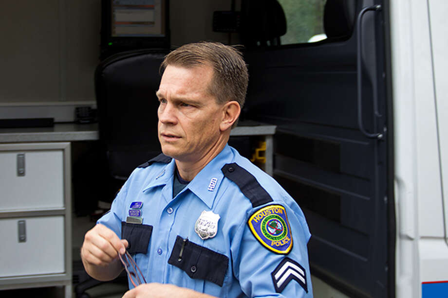 HPD Officer John Kitts is an intoxilyzer operator for the DWI task force. The B.A.T. van is the Blood Alcohol Testing Van. The task force is cracking down hard on drinking and driving over the New Year's holiday. / James Ridgway, Jr.