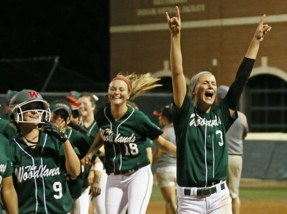 The Woodlands pitcher Abby Langkamp (3) exults with teammates Roma Thornton (9) and Emily Langkamp after the Lady Highlanders' 2-1 victory to clinch the Region II-5A finals against Rockwall in Waco. The Woodlands is headed to the state touranment. Photo: Louis DeLuca