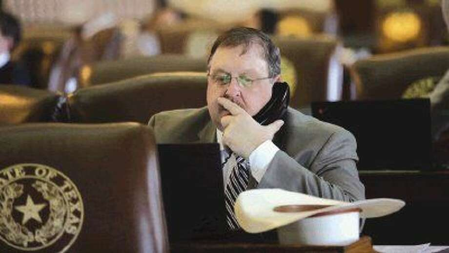 FILE - In this May 13, 2015 file photo, Texas Rep. Cecil Bell Jr., R-Magnolia, talks on the phone in the House Chamber, in Austin. Photo: Eric Gay