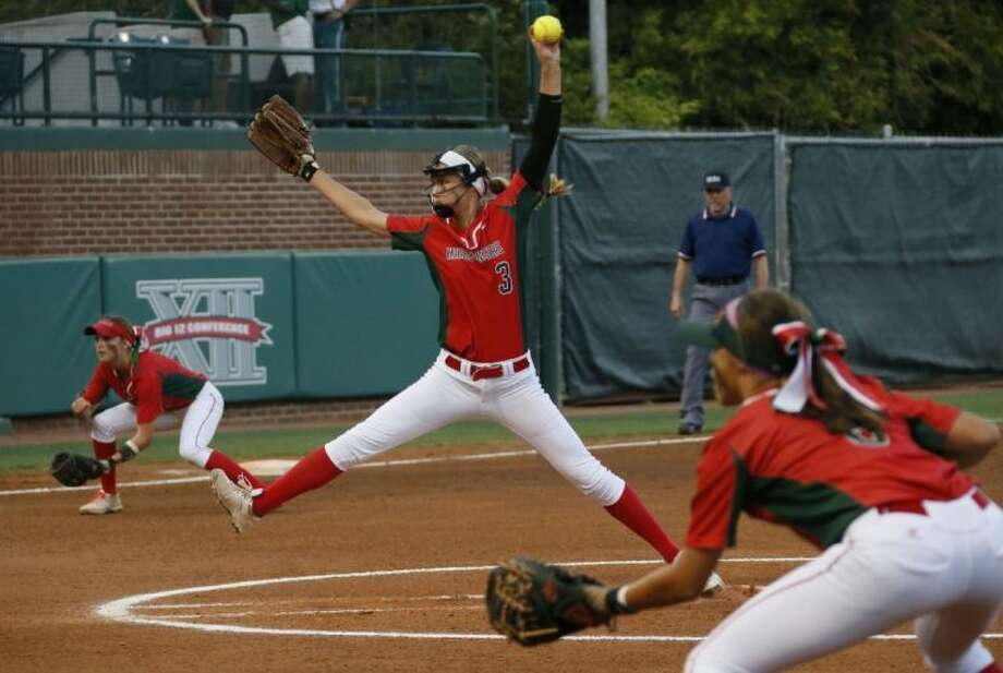The Woodlands' Abby Langkamp has guided the Lady Highlanders to the Class 5A state tournament. At left is third baseman Kaitlyn Stavinoha and at right Shelby Dublin, the Lady Highlanders' first baseman. Photo: Louis DeLuca