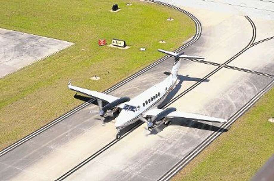 An aircraft taxis down a runway at Lone Star Executive Airport in Conroe. / @WireImgId=2677131