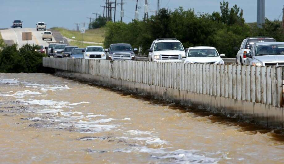 Traffic on U.S. 380 going over Lake Bridgeport, the lake level hitting the bottom of the bridge as areas flood around Bridgeport, Texas Saturday. Photo: Paul Moseley