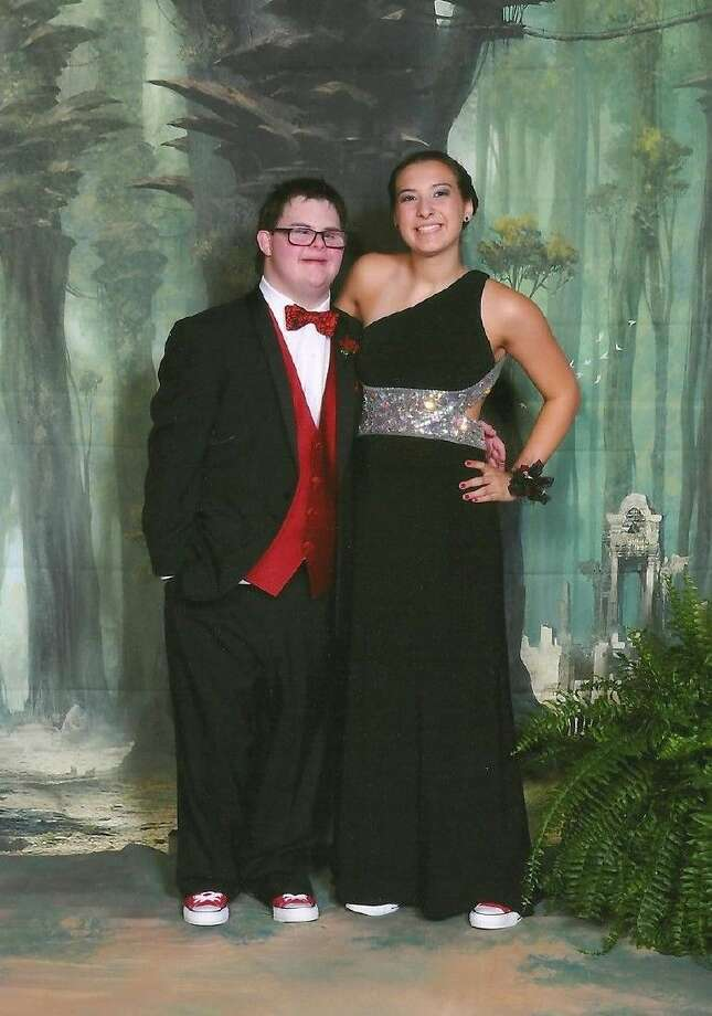 MHS senior Montana Klein, right, and Cole Anderson pose for a photo during their high school prom. The pair wore Spider Man-themed outfits to represent Anderson's favorite superhero.