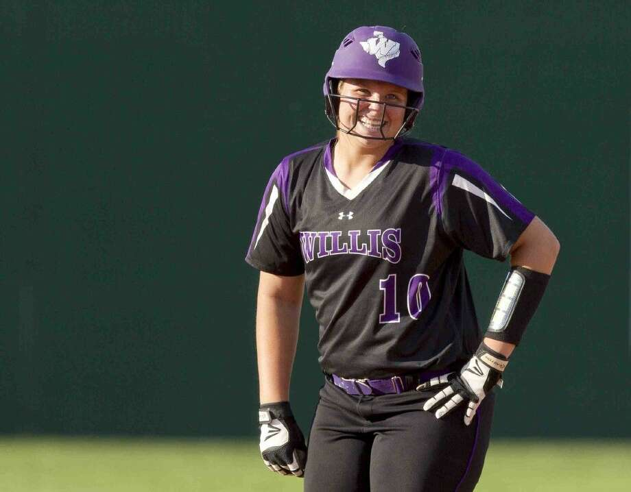 Willis' Casey Dixon laughs after reaching second base on an RBI double in the third inning of a District 18-5A softball game Thursday. Photo: Jason Fochtman