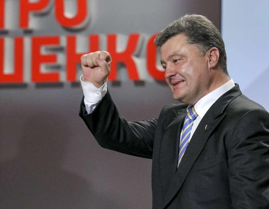 Ukrainian presidential candidate Petro Poroshenko reacts during his press conference in Kiev, Ukraine, Sunday, May 25, 2014. Photo: Mykola Lazarenko