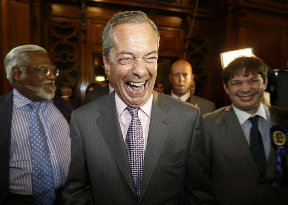 Nigel Farage leader of Britain's UK Independence Party (UKIP) laughs as he arrives to hear results of the south east region European Parliamentary Election vote at the Guildhall in Southampton, England, Sunday, May 25, 2014. From Portugal to Finland, voters of 21 nations cast ballots Sunday to decide the makeup of the next European Parliament and help determine the European Union's future leaders and course. Photo: Kirsty Wigglesworth