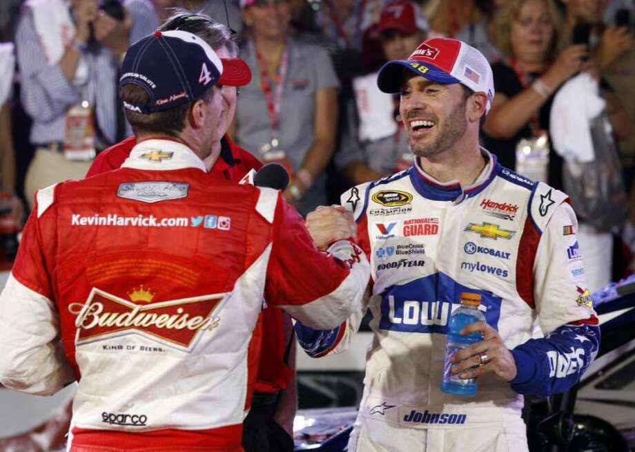 Jimmie Johnson, right, is congratulated by Kevin Harvick after winning the Coca-Cola 600 on Sunday night. Photo: Terry Renna