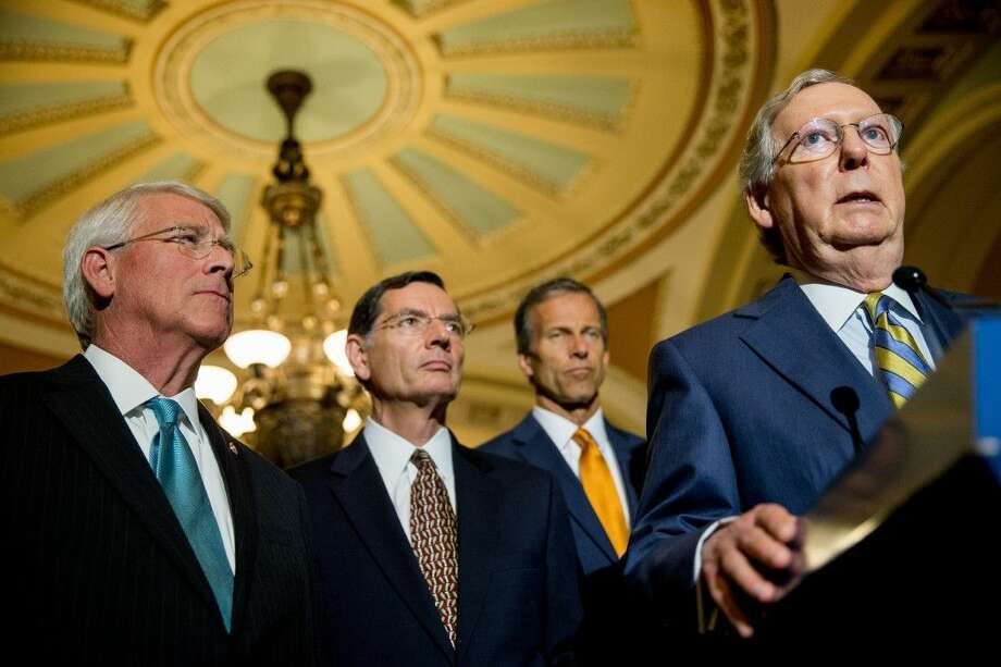 Senate Majority Leader Mitch McConnell of Ky., right, accompanied by, from left, Sen. Roger Wicker, R-Miss., Sen. John Barrasso, R-Wyo. and Sen. John Thune, R-S.D., speaks to the media during a news conference on Capitol Hill in Washington, Tuesday. Photo: Andrew Harnik