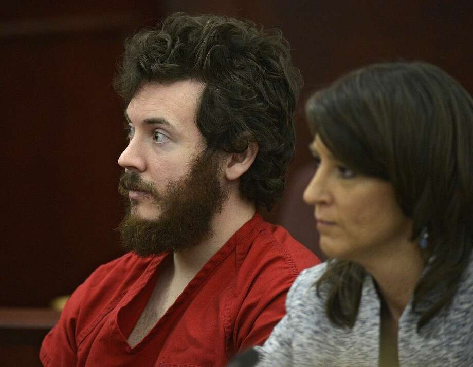 FILE - In this March 12, 2013, file photo, James Holmes, left, and defense attorney Tamara Brady appear in district court in Centennial, Colo., for his arraignment. Prosecutors are methodically building a case that Holmes knew right from wrong when he planned and carried out the deadly Colorado theater shooting, hoping to convince jurors that he should be convicted and executed and not sent to a mental hospital. (RJ Sangosti/The Denver Post via AP, Pool, File) Photo: RJ Sangosti