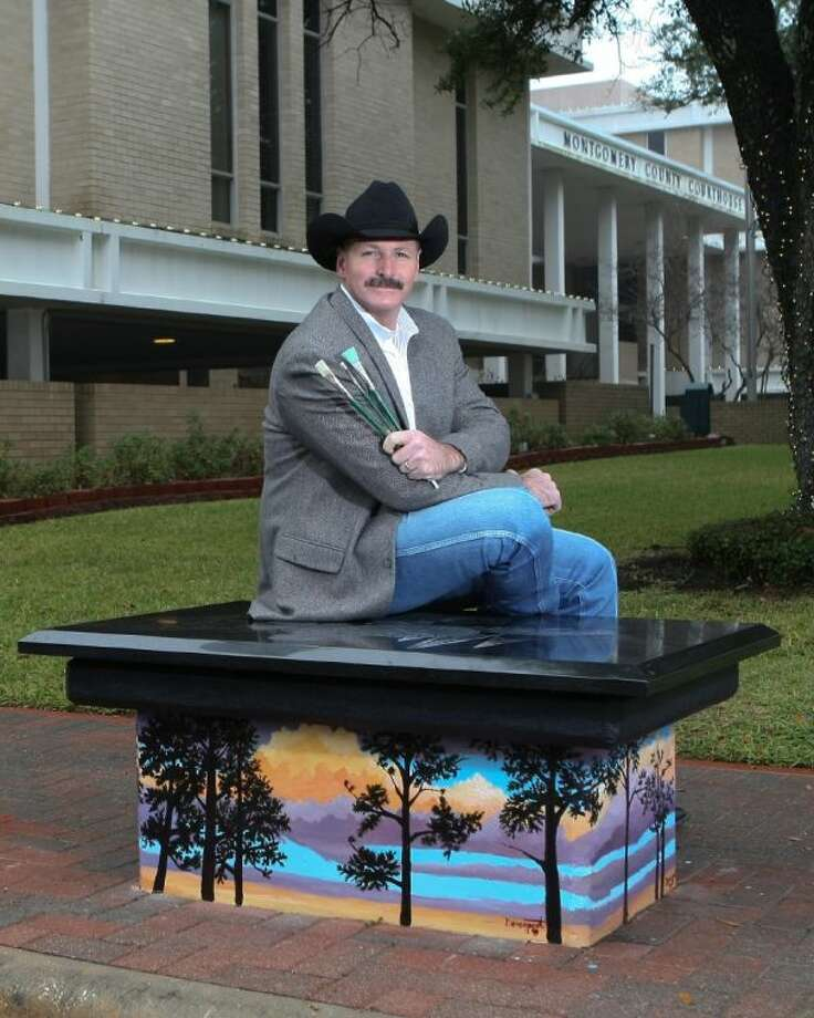 "Pictured is one of the 13 completed Conroe Art Benches, and the artist for that bench, Joe Davenport. This bench design was rendered in etched granite and paint and is titled, ""Conroe History in Brief."""
