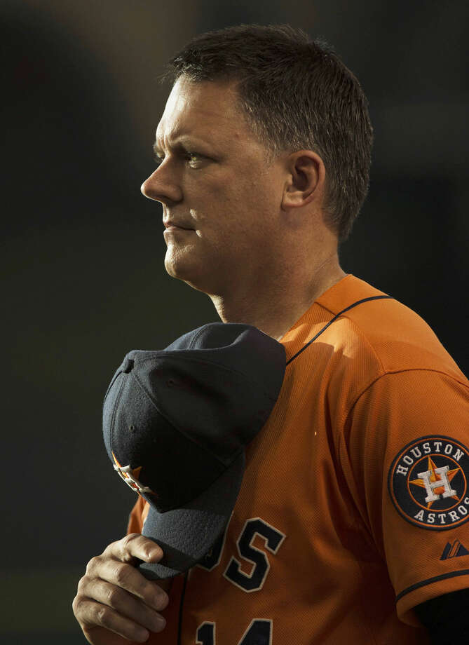 Houston Astros manager A.J. Hinch (14) stands during the national anthem before his team faced the Chicago White Sox in a baseball game Friday, May 29, 2015, in Houston. (AP Photo/George Bridges) Photo: George Bridges