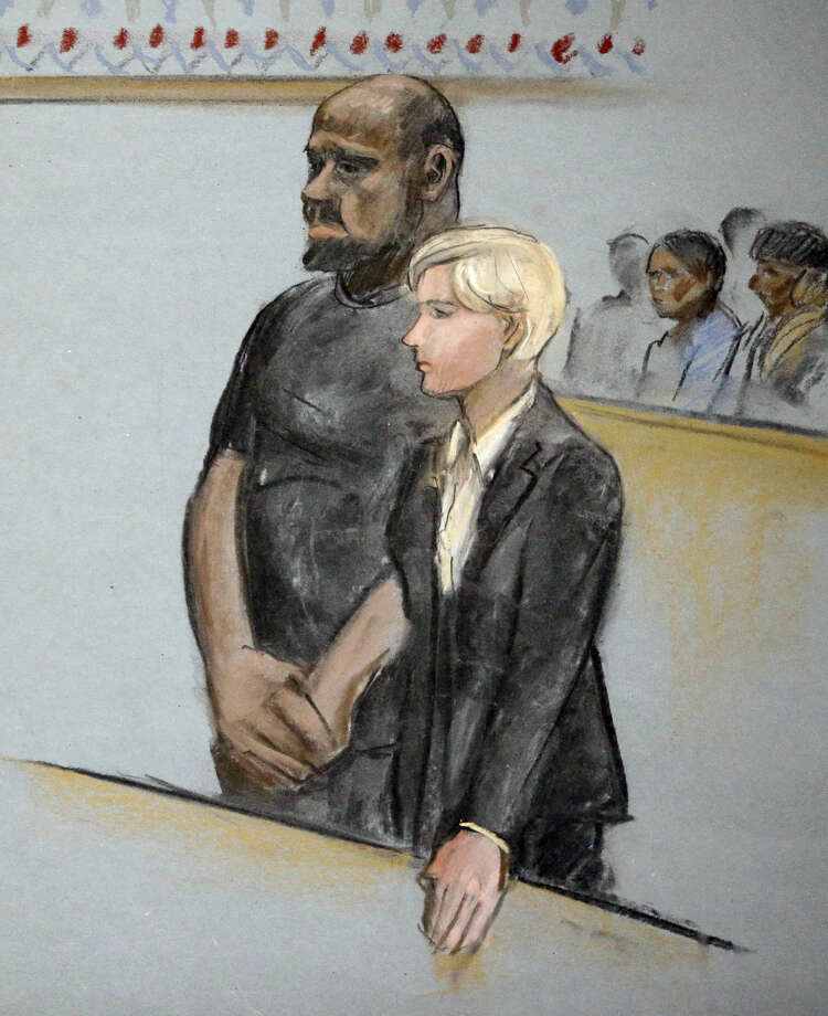 In this courtroom sketch, David Wright, left, is depicted standing with his attorney Jessica Hedges, right, during a hearing Wednesday, June 3, 2015, in federal court in Boston. Wright was ordered held Wednesday on a charge of conspiracy with intent to obstruct a federal investigation in the case of Usaama Rahim, who while under surveillance by terrorism investigators, was killed after he lunged with a knife at a Boston police officer and an FBI agent. (Jane Flavell Collins via AP) Photo: Jane Flavell Collins