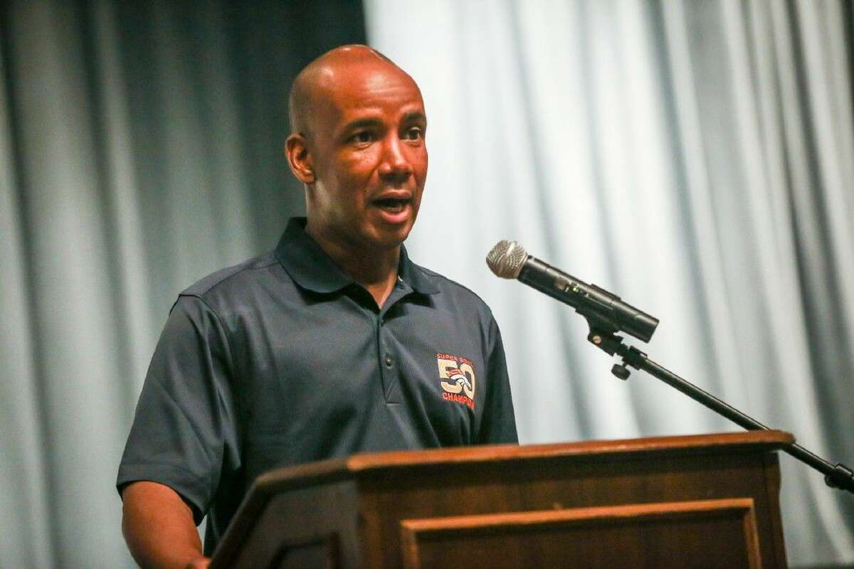 Broncos wide recivers coach Tyke Tolbert speaks to students on Friday at Conroe High School.