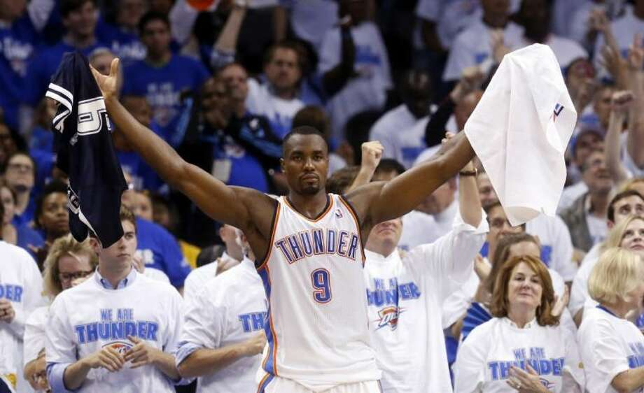 Oklahoma City Thunder forward Serge Ibaka celebrates after a three-point basket by teammate Derek Fisher late in the fourth quarter of Game 4 of the Western Conference finals against the San Antonio Spurs on Tuesday in Oklahoma City. The Thunder won 105-92. Photo: Sue Ogrocki