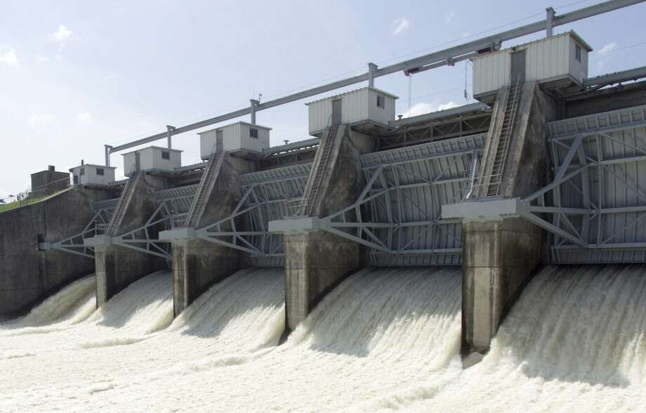 Water is released from the Lake Conroe Dam into the San Jacinto River recently in Conroe. Photo: Jason Fochtman
