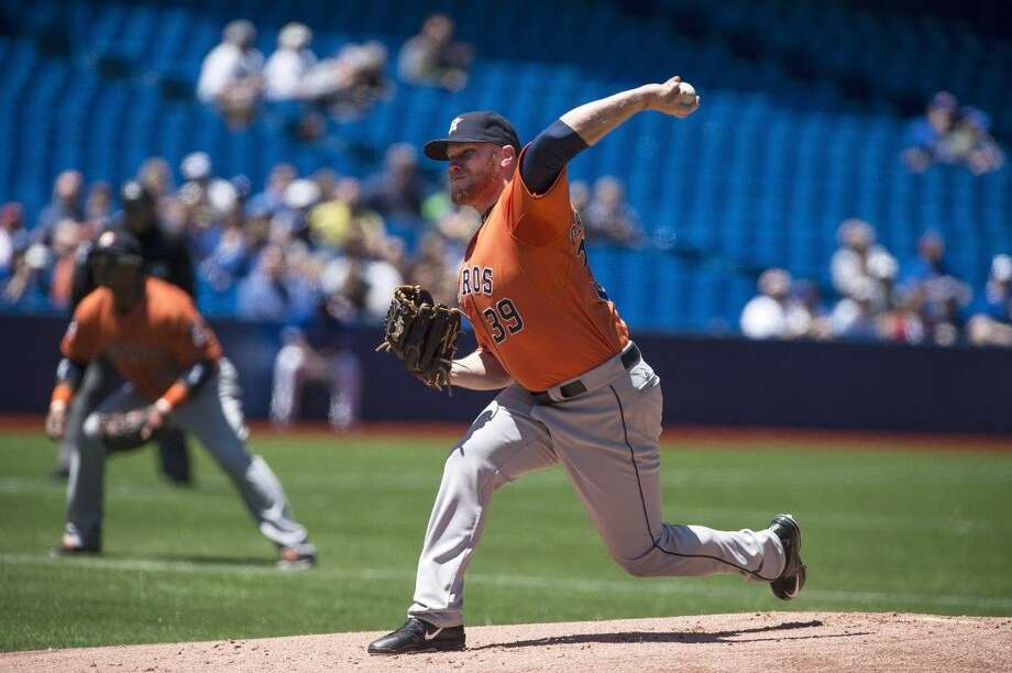 Houston Astros starting pitcher Brett Oberholtzer pitches against the Toronto Blue Jays during first inning action in Toronto on Saturday. Photo: Aaron Vincent Elkaim
