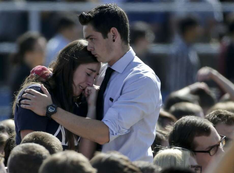 A couple embrace before a memorial service for the victims and families of Friday's rampage at Harder Stadium on the campus of University of California, Santa Barbara on Tuesday, May 27, 2014 in the Isla Vista area near Goleta, Calif. Sheriff's officials said Elliot Rodger, 22, went on a rampage near the University of California, Santa Barbara, stabbing three people to death at his apartment before shooting and killing three more in a crime spree through a nearby neighborhood.
