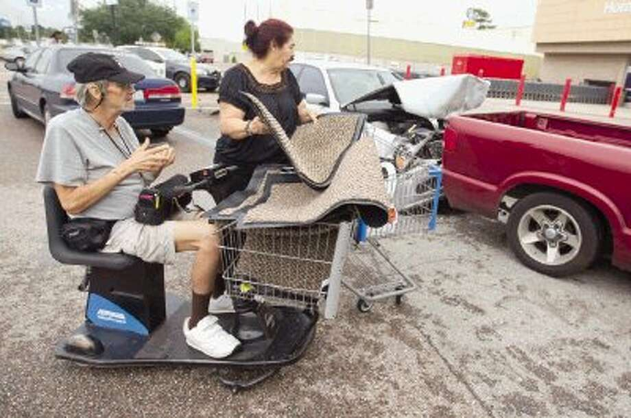 Cliff and Gloria Wooldridge, of Willis, looks over their truck after a three-car wreck in front of Walmart in Conroe Wednesday morning. Photo: Jason Fochtman / Conroe Courier