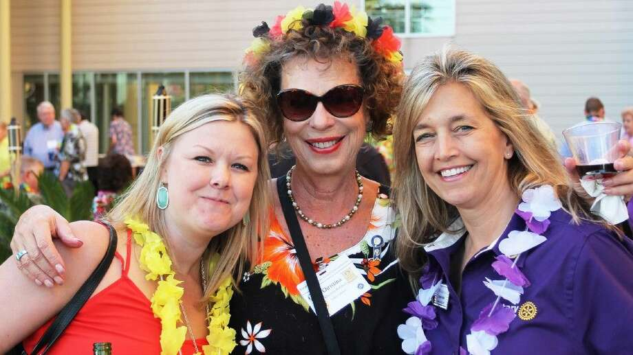 Rotarians from Lake Conroe Audrey Blevins Winkle, Christina Rathbun and Lorrie Parker at the Rotary District 5910 Conference Beach Party.