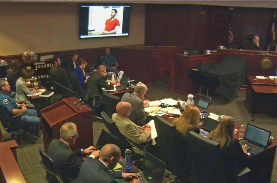 Defendant James Holmes appears in a video presented to a darkened courtroom in Centennial, Colo., Thursday. Photo: Uncredited