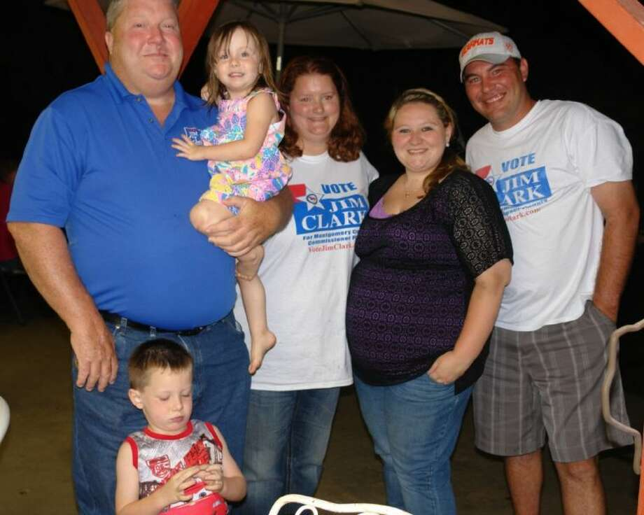 Jim Clark poses for a photo with his family and campaign manager David Tyler (right) during his victory party at the home of Billy Bob Lee in East Montgomery County Tuesday night.