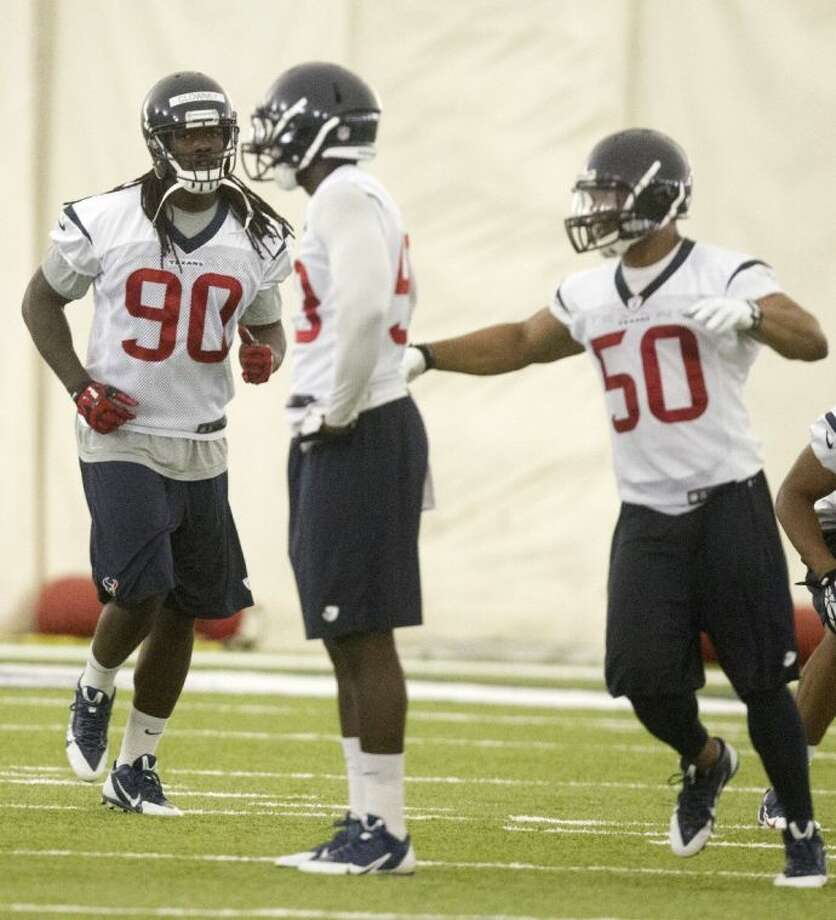 Houston Texans outside linebacker Jadeveon Clowney (90) runs through a drill during minicamp on Tuesday in Houston. Photo: Patric Schneider