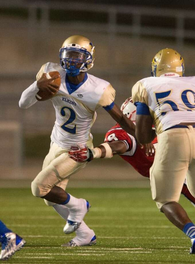 Johnathan Giles (2), Billy Young (59) and Elkins got back on track with a 74-7 victory against Westbury on Sept. 21. The Knights begin District 23-5A play Sept. 27 against Clements at Mercer Stadium. Photo: Kevin Long/GulfCoastShots.com