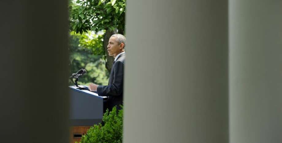 President Barack Obama speaks about the future of American troops in Afghanistan Tuesday in the Rose Garden of the White House. Obama wants to keep 9,800 U.S. troops in Afghanistan after the war formally ends later this year and then will withdraw most of those forces by 2016.