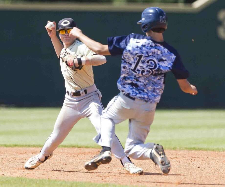 Shortstop Tyler Linneweber, of Conroe, turns a double play as Kingwood's Preston Meinhardt slides in during the fifth inning of a District 16-6A baseball game Saturday at Kingwood High School. Go to HCNpics.com to purchase this photo and others like it. Photo: Jason Fochtman