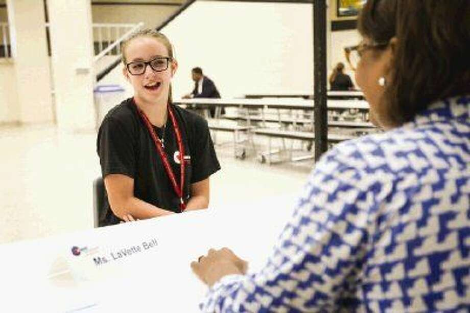 Brooke Hertzenberg, left, goes through a mock interview with LaVette Bell during Conroe ISD's annual leadership academy for seventh-graders entering the eighth grade Tuesday at Conroe High School. Photo: Michael Minasi